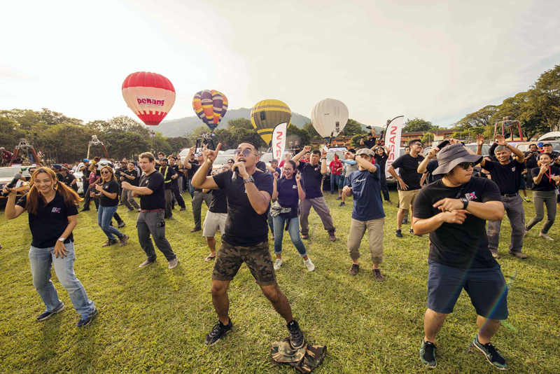 Performance by the international pilots and committee with Tethered Balloons as background
